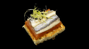 Anchovy with tomato jelly and onion shoots