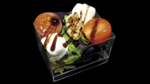 Mozzarella cheese salad with cherry tomatoes and walnuts